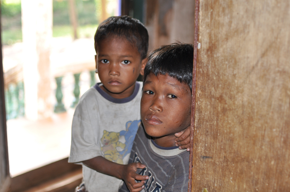 Two Cambodian boys look to the camera