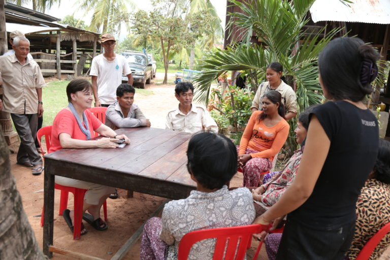 Founder and Cambodian Crew in Discussion