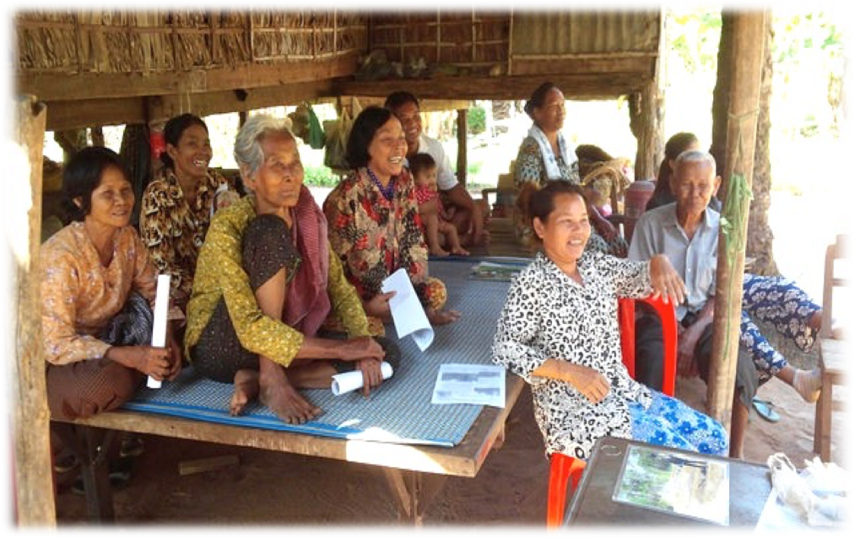 Cambodian farmers listening to a discussion.
